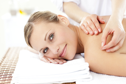 Smiling caucasian woman receiving an acupuncture treatment